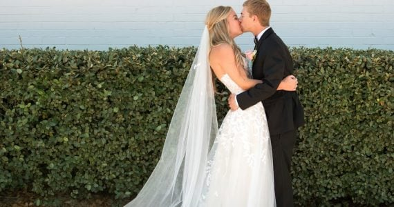 real bride Fallon on her wedding day kissing her groom