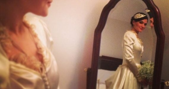 vintage wedding gown on bride on her wedding day in a mirror reflection artistic shot
