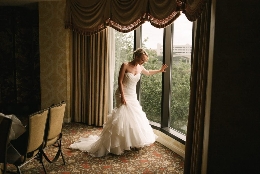 beautiful bride by window on her wedding day