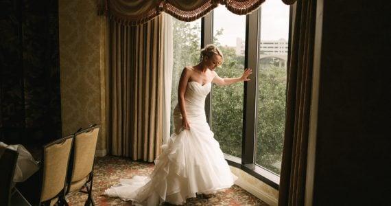 beautiful bride by window on her wedding day