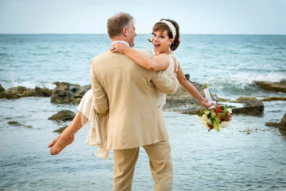 beach: happy bride and groom on their wedding day