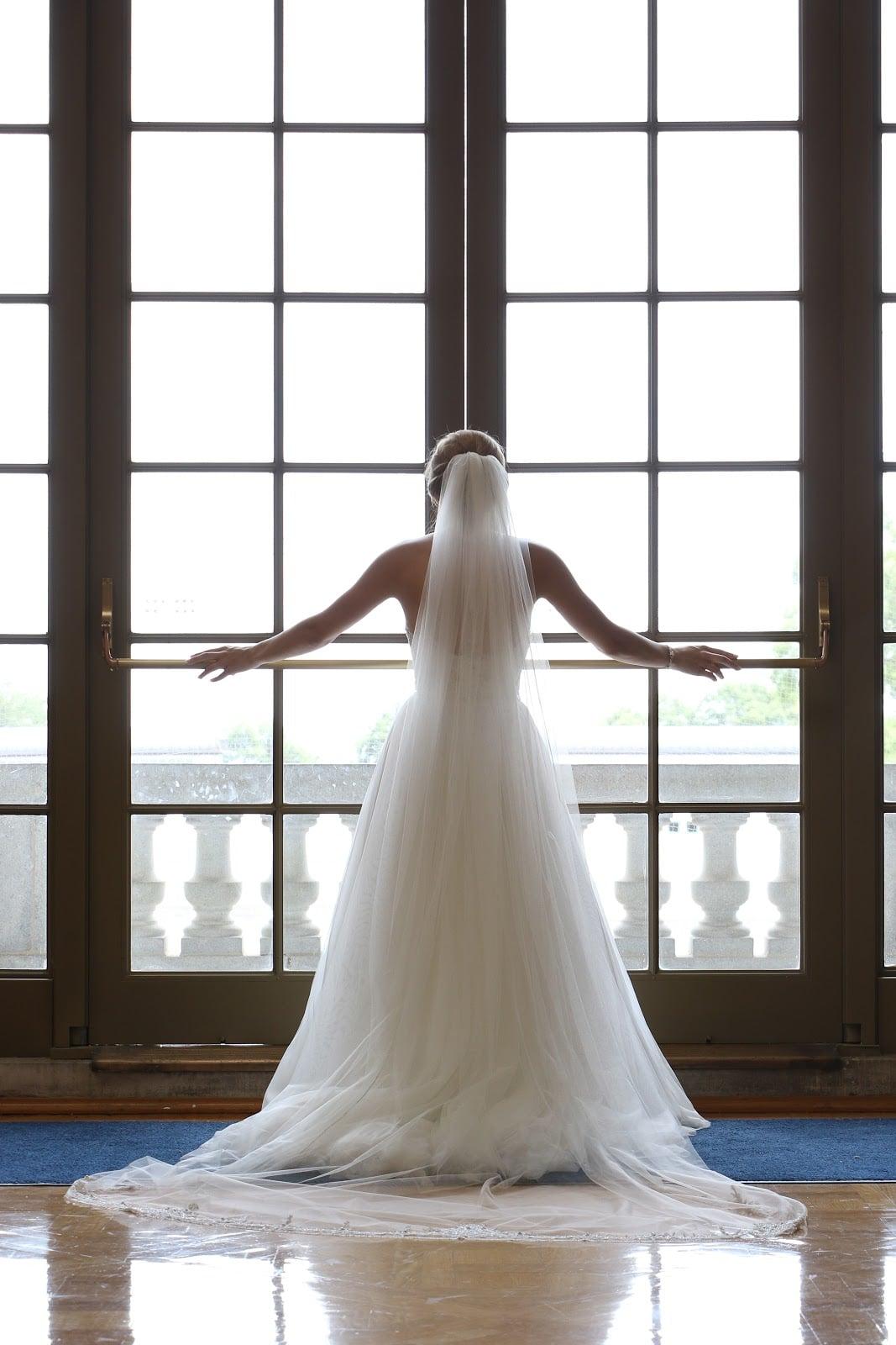 Bride's back in window frame