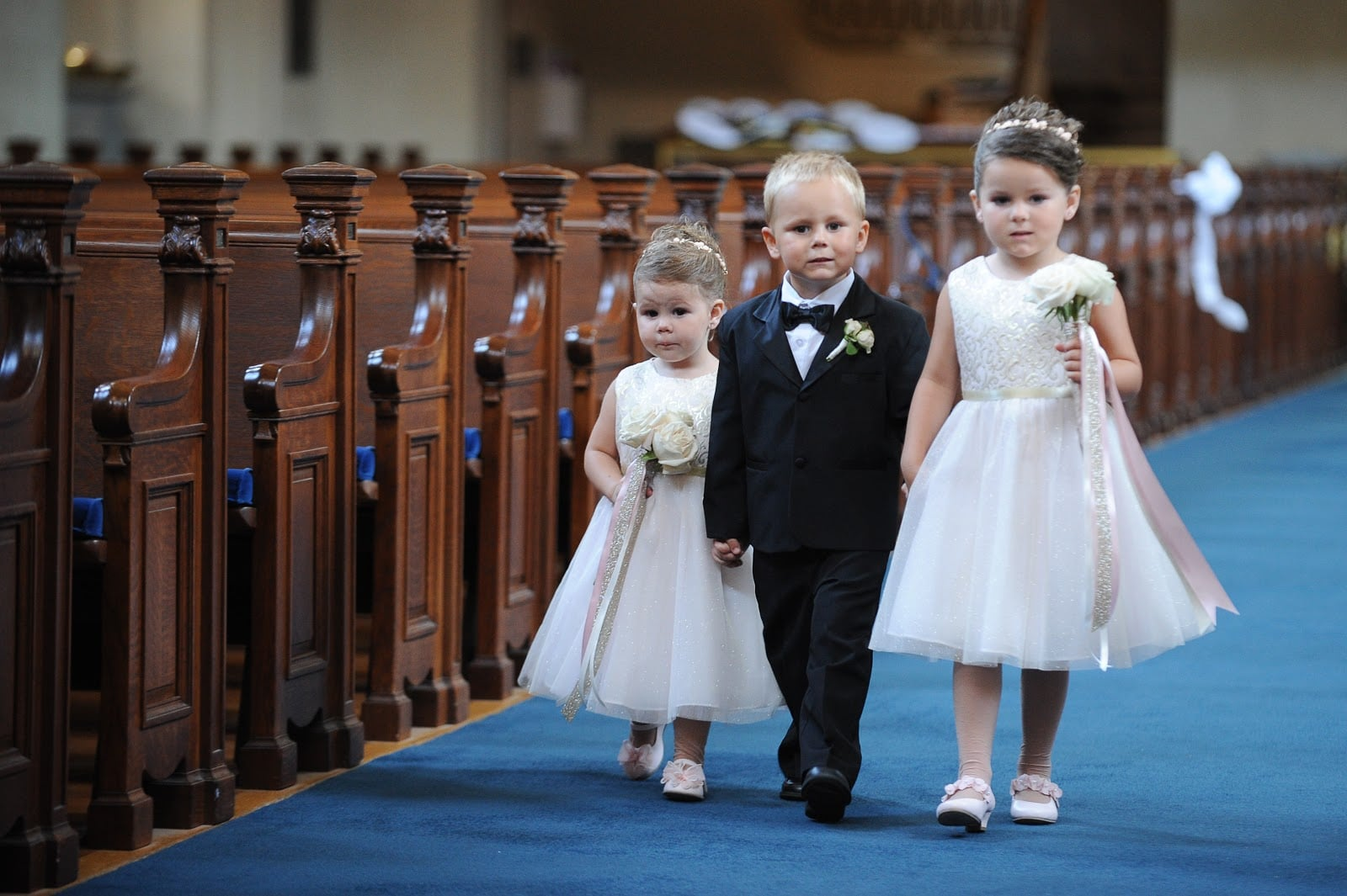flower girls and ring-bearer in church
