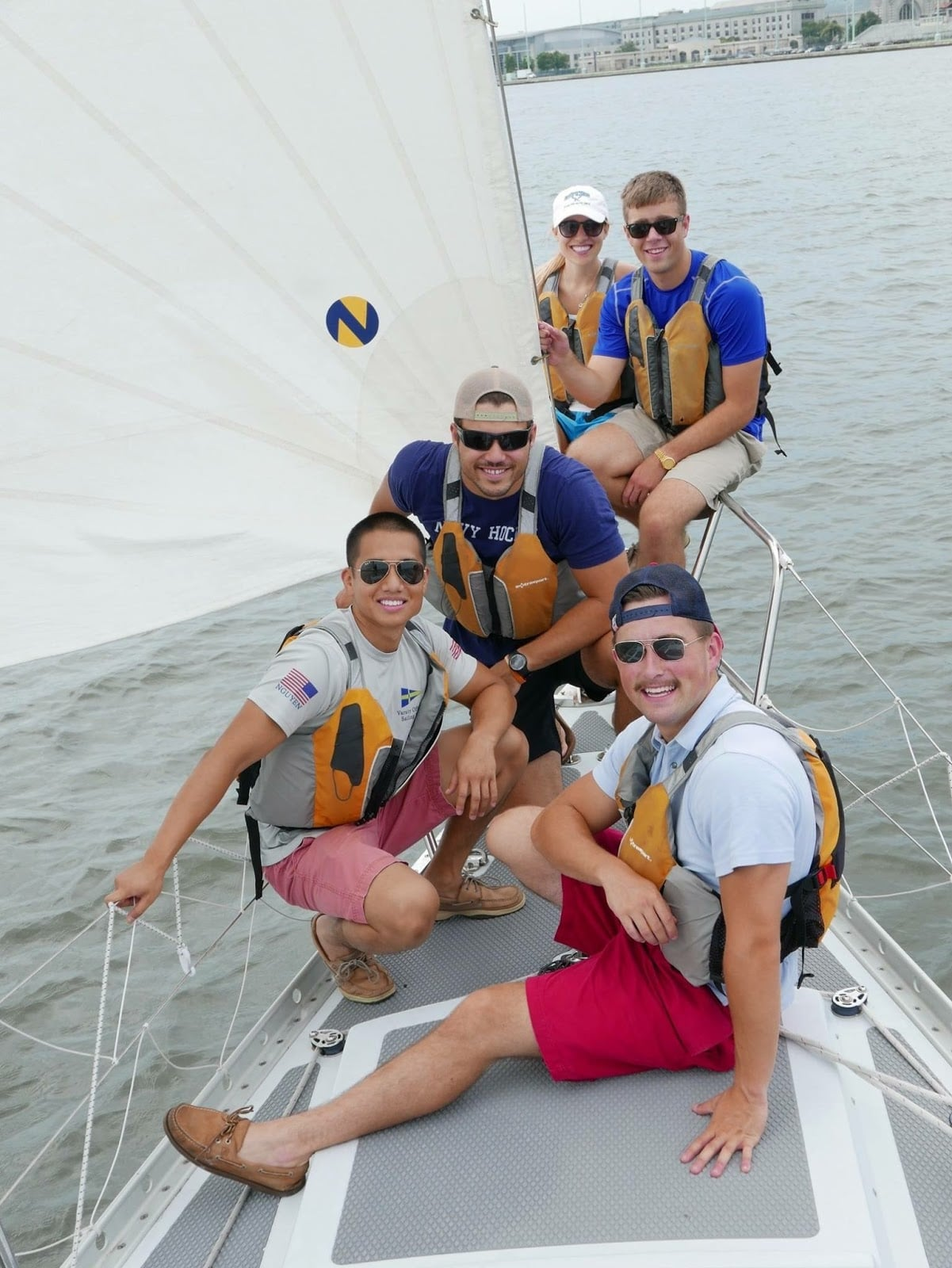 sailing bride and groom with friends