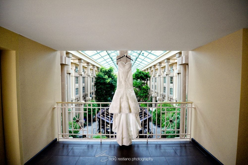 Real Bride Carolina's Matthew Christopher wedding gown displayed in a mezzanine before the wedding day.