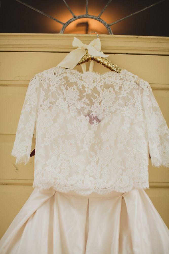Hanging Paloma Blanca wedding gown.