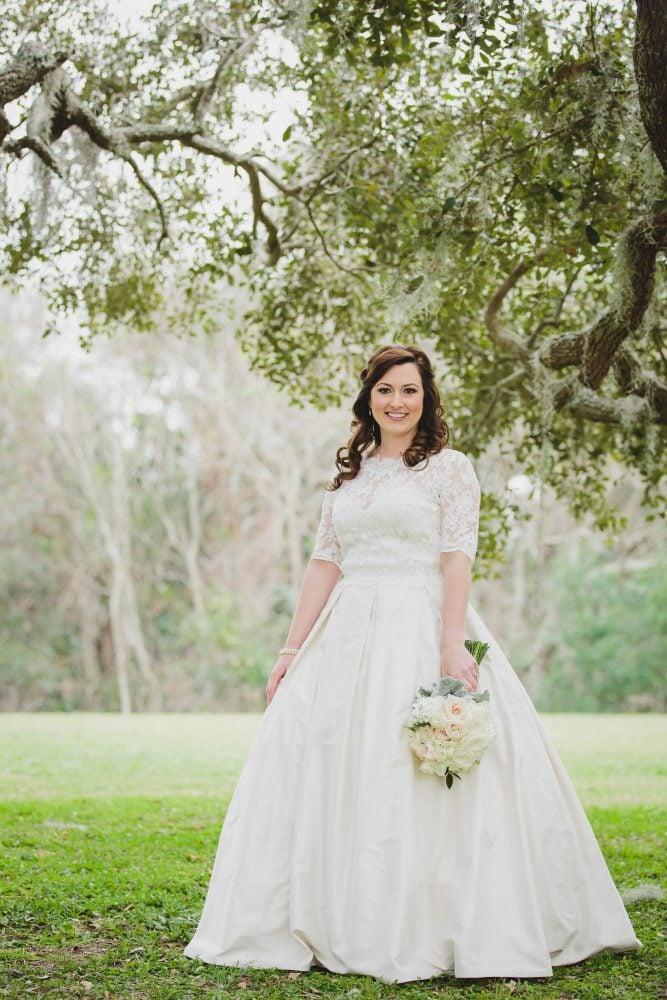Real Bride Laura wedding portrait in Paloma Blanca wedding gown.