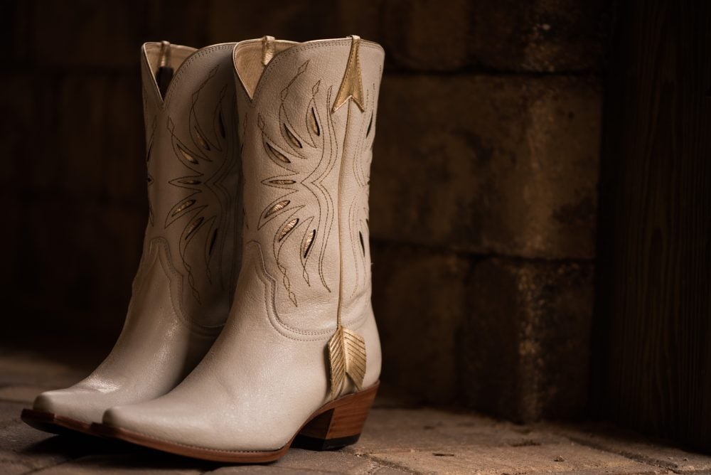 Beige cowboy wedding boots.