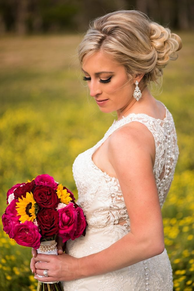Outdoors portrait of bride with bridal bouquet.