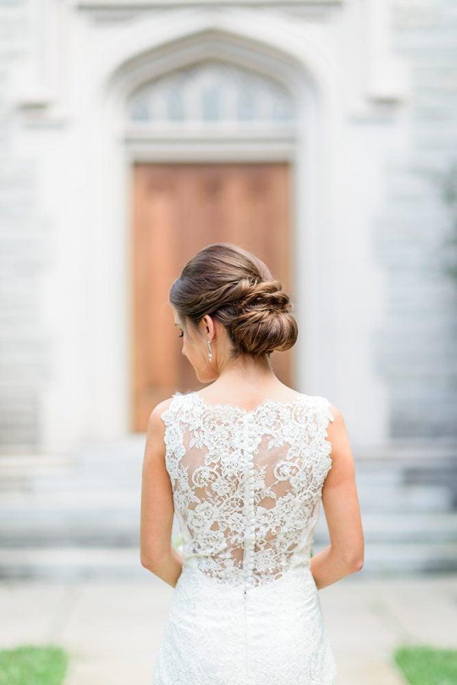 Bride in Augusta Jones wedding gown - back detail view.