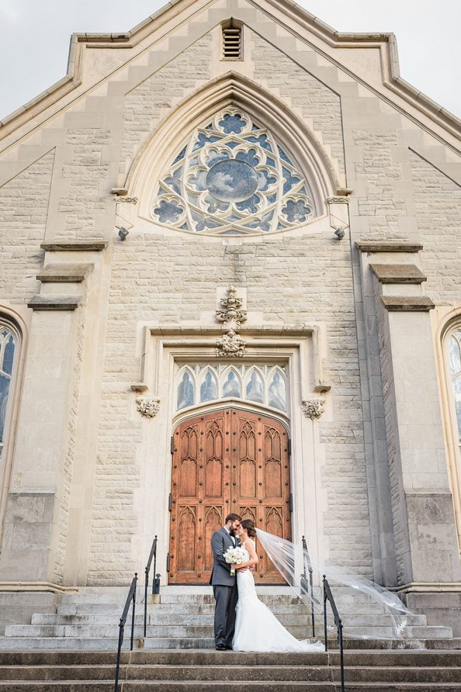Wedding portrait of Real Bride Emily and her groom at the cathedral.