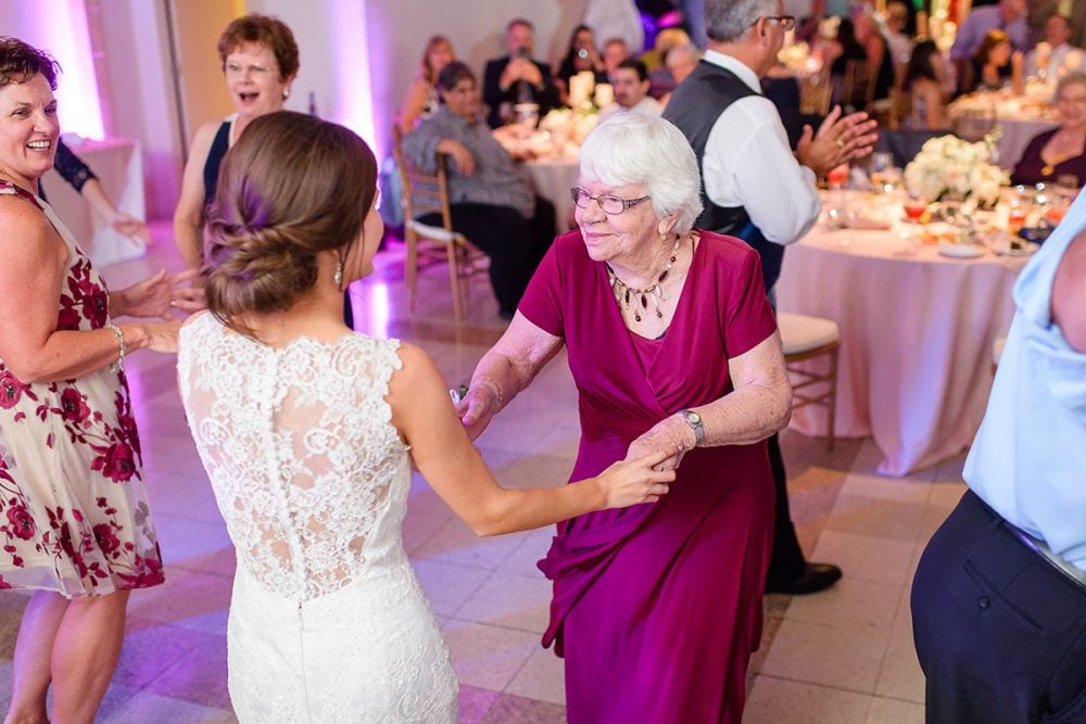 Bride Emily dancing on her wedding day with her grandmother.