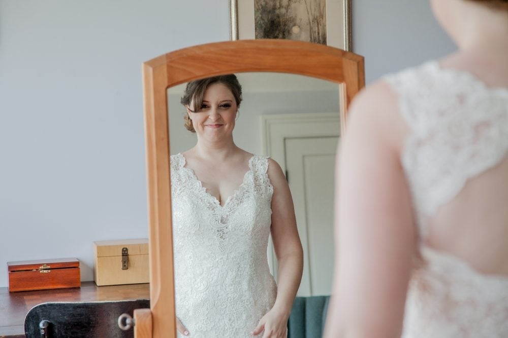 Mirror shot of AWGS member Orange Restoration Labs' Real Bride Megan on her wedding day.