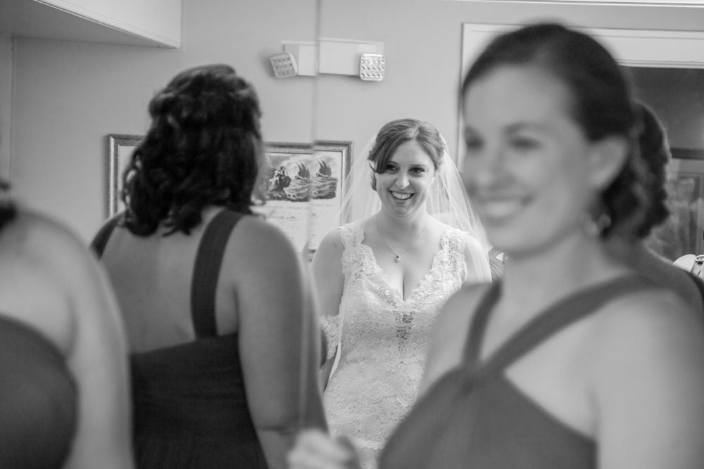 Black and white shot of Real Bride Megan with bridesmaids on her wedding day.