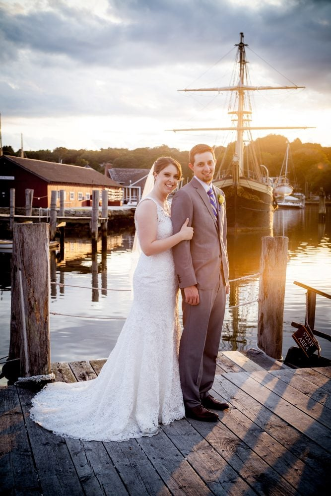 Real Bride Megan wearing a Rebecca Ingram for Maggie Sottero wedding dress with her groom at their wedding day in Mystic Seaport, Connecticut.