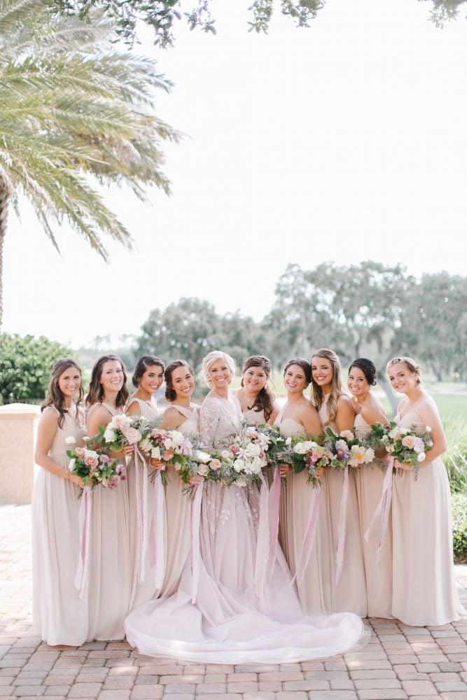 Real Bride Alexa and her bridesmaids wedding portrait.