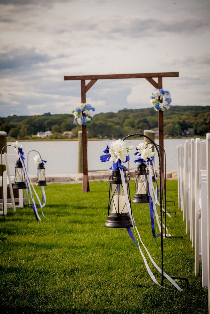 A scenic shot from Real Bride Megan's wedding ceremony in Mystic Seaport, Connecticut.