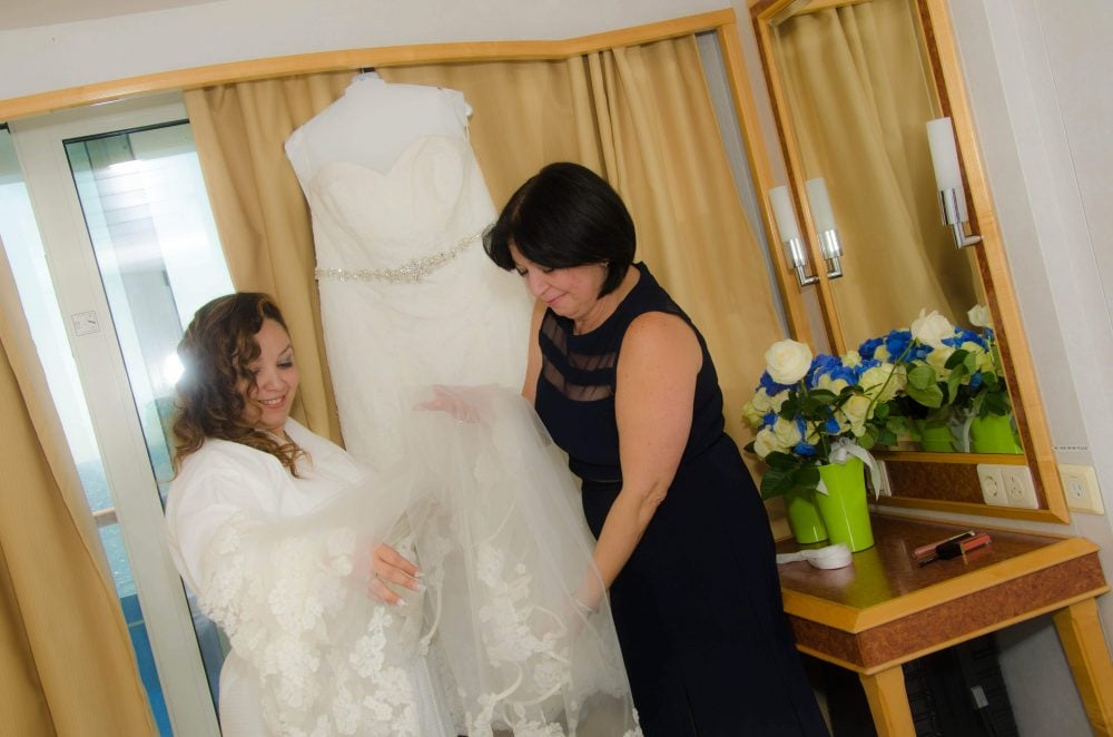 Real Bride Zacha admiring her restored veil with her mother-in-law.