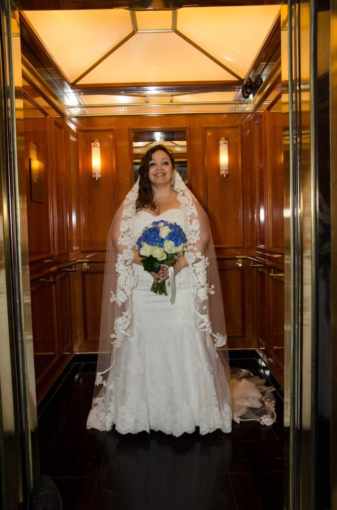 Real Bride Zacha on her wedding cruise wearing the vintage wedding veil Orange Restoration Labs in CT restored for her.