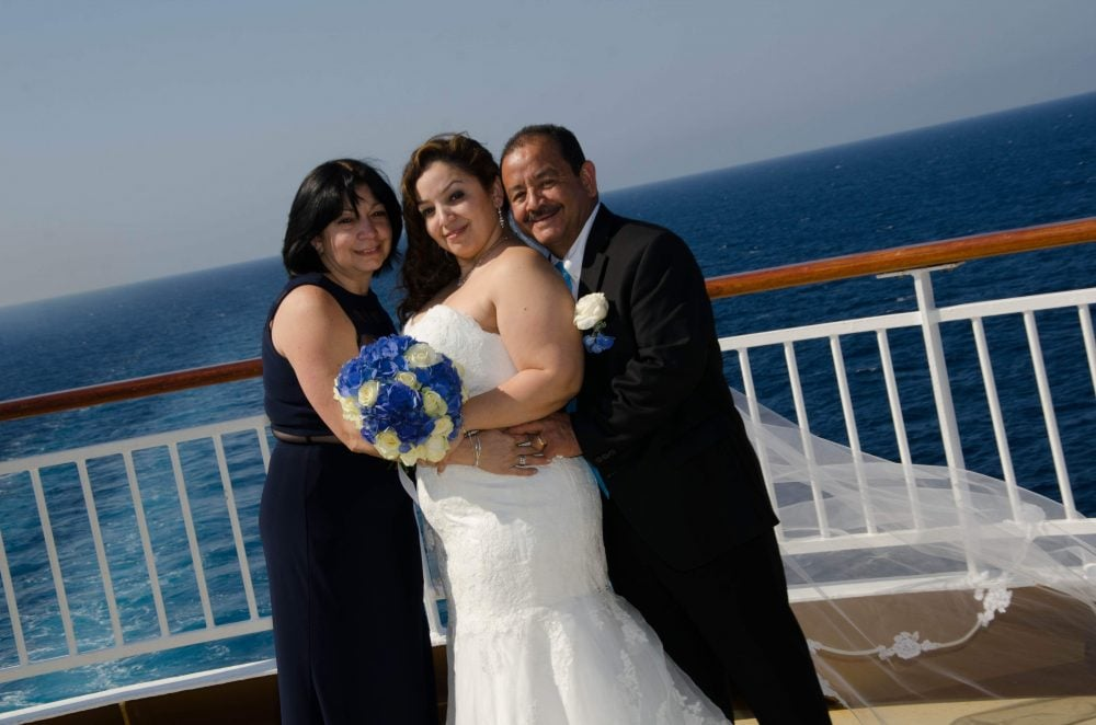 Real bride Zacha with her parents on her destination wedding cruise.