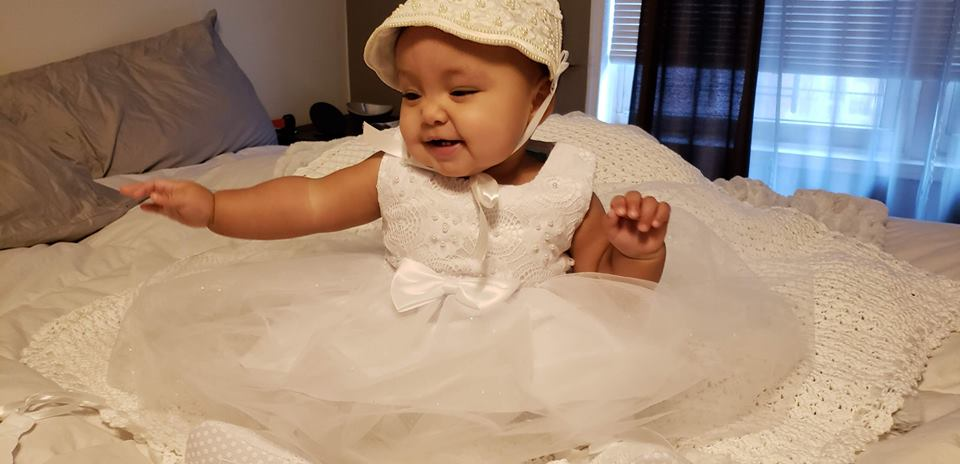 Real bride Zacha's adorable baby girl in bonnet restored and customized by Sally Conant of Orange Restoration Labs in CT.