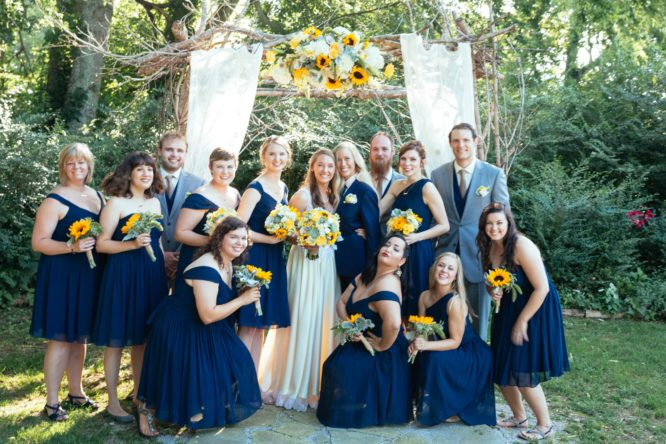 Real brides Shelby and Jessica and their wedding party on their wedding day in Columbia, TN