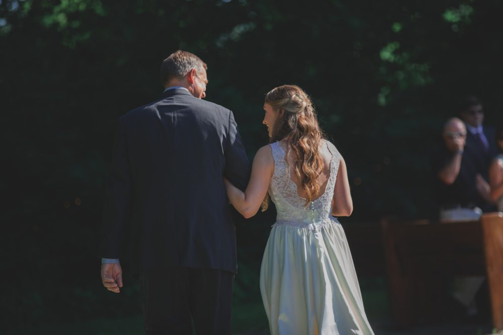 Real bride Shelby with her Dad, walking up to the altar on her wedding day in Columbia, TN