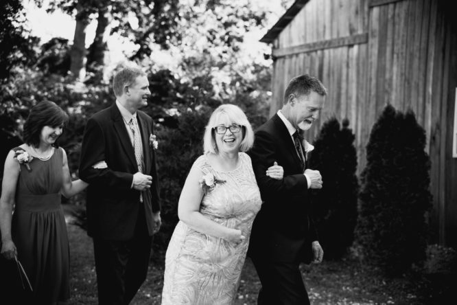 Black-and-white wedding portrait of Real bride Shelby's new and beloved in-laws.